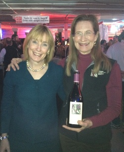 New Hampshire Gov. Maggie Hassan and Merry, with a bottle of Meredith Estate Pinot, during NH Wine Week, January 2013