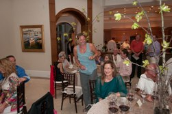 Host Candis Wilson introduces Merry during the Destin Charity Wine Auction, May 2012