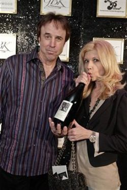 Kevin Nealon and friend in the gift lounge at the Academy Awards with a magnum of Merry Edwards, March 2012