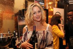 Teri Polo in the gift lounge at the Academy Awards with a Merry Edwards magnum, March 2012